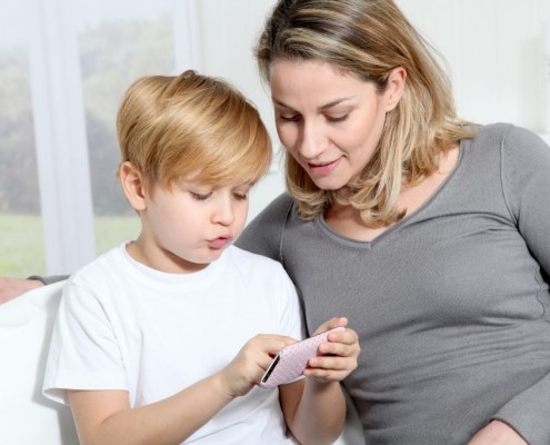 bigstock-Mother-and-son-playing-video-g-17007992-1024x683